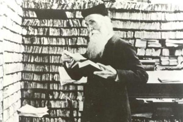 James Murray surrounded by papers in the Scriptorium at Banbury Road before 1910